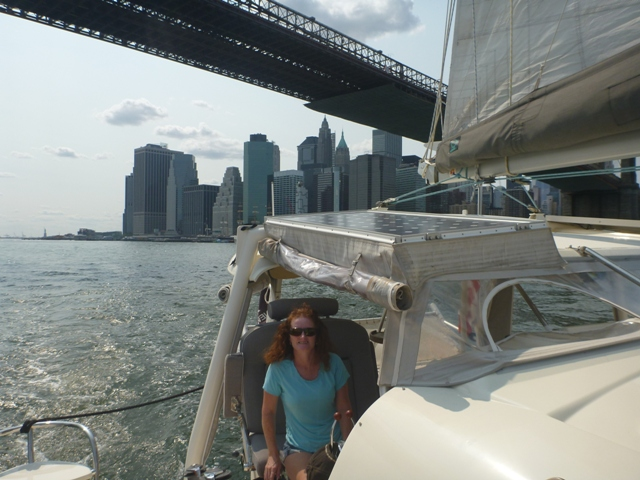 Under Brooklyn bridge with Manhattan behind