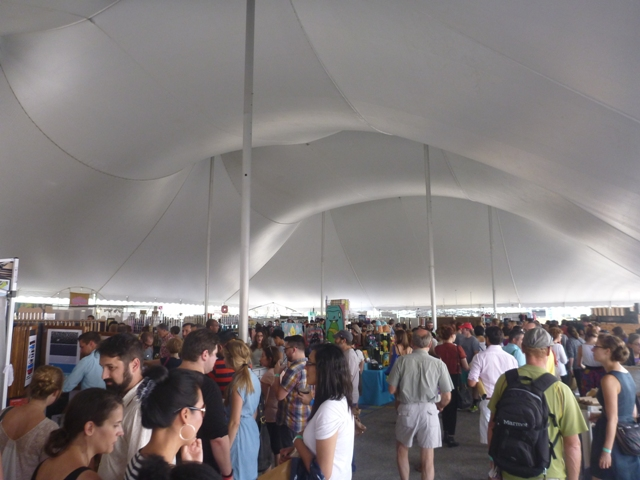 Brett went thru every row at this mkt and this is only 1 tent by the way! Can you spot him.