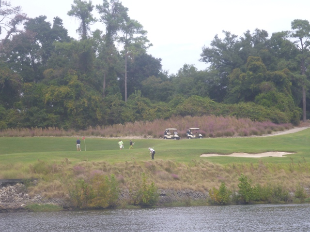 This golf course looks pretty from the canal