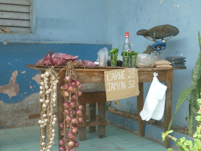 Meat, ham, onions and peppers for sale