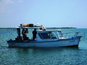 local fishermen who traded with us, 4 men sleep in this small boat