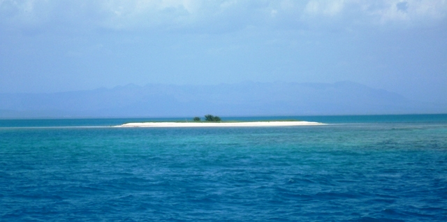 A small Cay surrounded by reefs