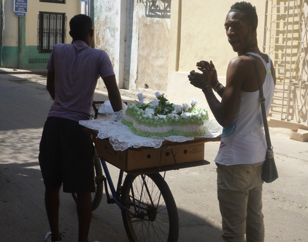 Bikes are used to transport all sorts of things; yes even wedding cakes