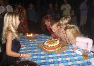 The kids helped Jen blow the candles out