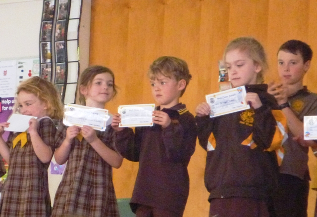 Ruben receiving a certificate at school assembly