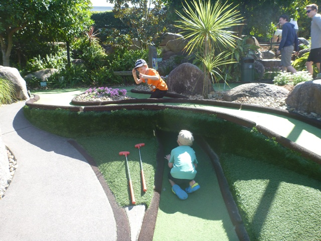 Mini golf or is it playing in the tunnels? Oh well they are having fun!