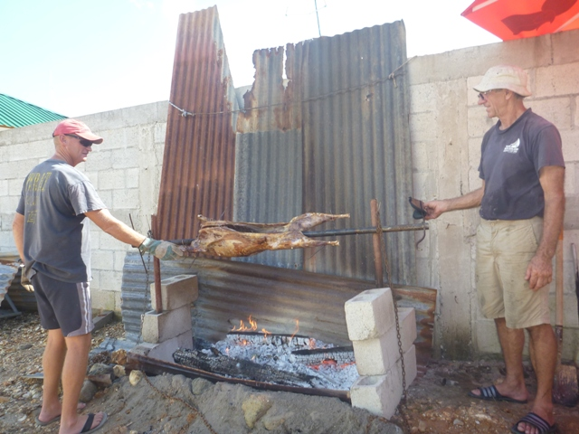 Brett & Brian setting up a system to rotate the lamb on the spit