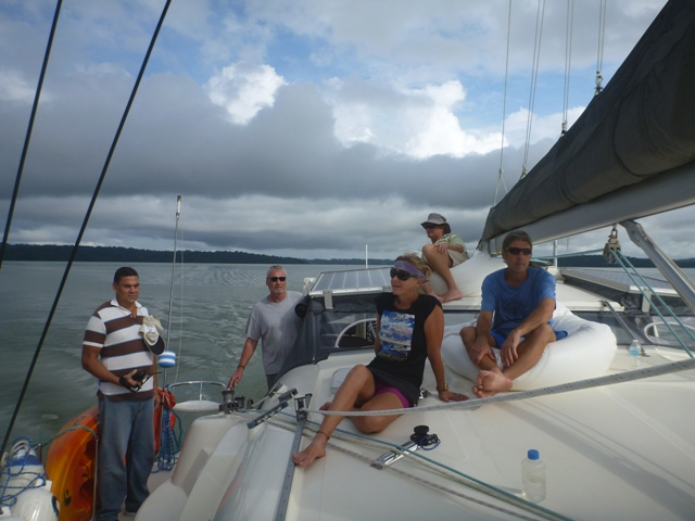 The crew all looking very relaxed cruising in Gatun Lake